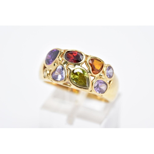 42 - A YELLOW METAL RING, a wide band set with eight various cut coloured stones, assessed as orange sapp...