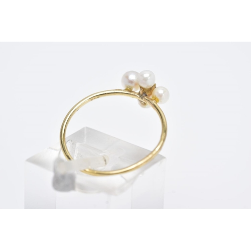 43 - A 9CT GOLD RUBY AND PEARL RING, set with a central circular cut ruby within a four cultured pearl su...
