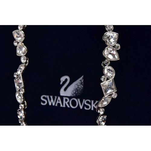 47 - A WHITE METAL SWAROVSKI CRYSTAL NECKLACE, of an articulated design set with various cut colourless c...