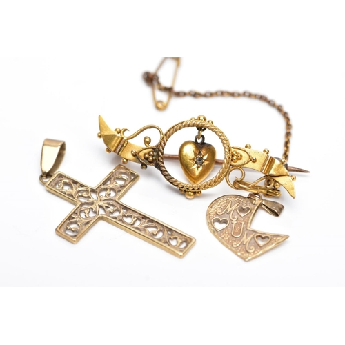 50 - A 9CT GOLD CROSS PENDANT AND A YELLOW METAL BROOCH AND PENDANT, the cross pendant with an openwork s...
