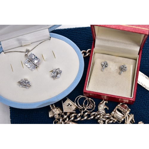 56 - A BOX OF ASSORTED SILVER AND WHITE METAL JEWELLERY, to include a silver charm bracelet suspending fo...