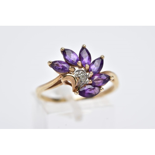 7 - A 9CT GOLD AMETHYST AND DIAMOND RING, designed with a spray of six marquise cut amethysts with a cen...