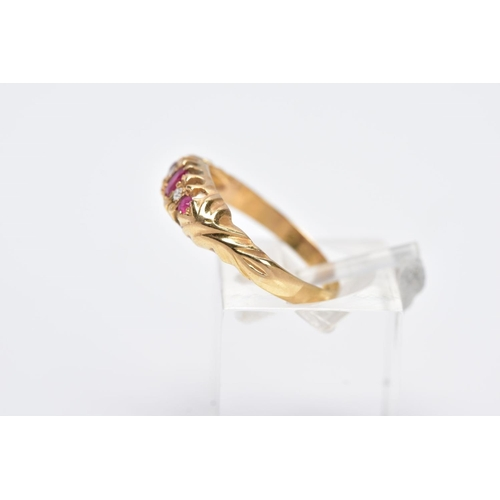 9 - AN EARLY 20TH CENTURY 18CT GOLD BOAT RING, designed with a central oval cut ruby interspaced with si...