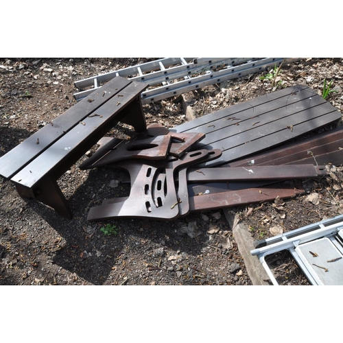 1008 - A DISASSEMBLED GARDEN SET comprising a slatted garden table and bench together with an assembled ben...
