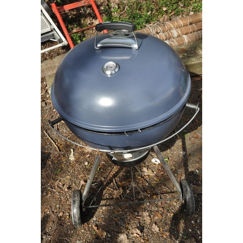 1009 - A WEBER MASTER-TOUCH BBQ with accessories and cover