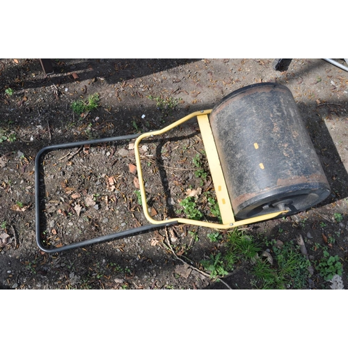 1012 - A MODERN GARDEN ROLLER with a yellow and black tubular metal folding handle and a welded steel rolle...