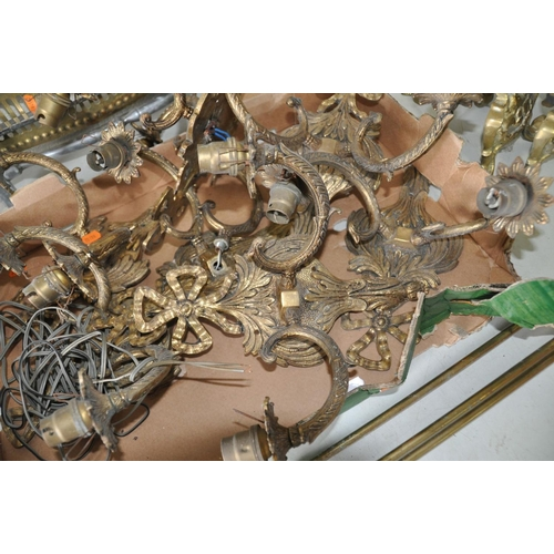 1078 - TWO TRAYS OF BRASSWARE including two sets of fire dogs, six wall lamps with feather, rope and swag d...
