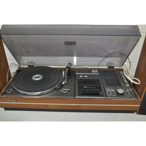 1088 - A VINTAGE SHARP SG-315E MUSIC CENTRE with two speakers (PAT pass and working except Tape player)