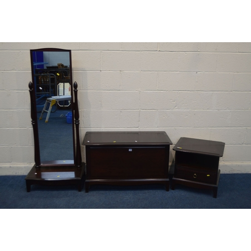 1052 - THREE VARIOUS STAG MINSTREL BEDROOM FURNITURE, to include a cheval mirror, blanket chest and a bedsi...