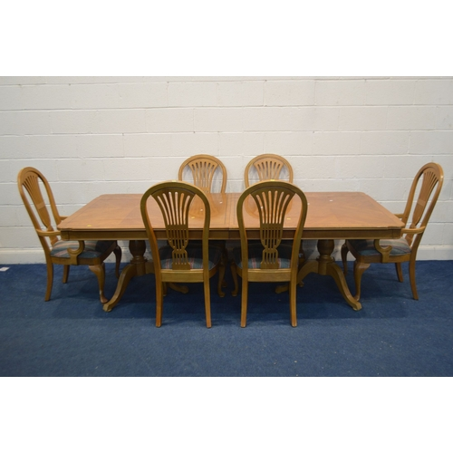 1060 - A HARDWOOD FINISH EXTENDINING DINING TABLE, with two additional leaves, length 245cm x closed length...
