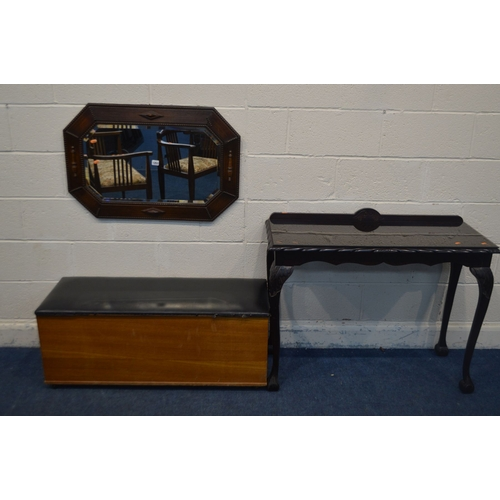 1061 - AN EARLY TO MID 20TH CENTURY OAK BEVELLED EDGE WALL MIRROR, with canted corners, 85cm x 57cm along w...