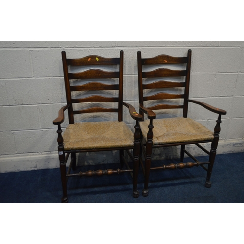 1068 - A PAIR OF 20TH CENTURY GEORGIAN STYLE ELM AND OAK LADDERBACK ELBOW CHAIRS with rush seats