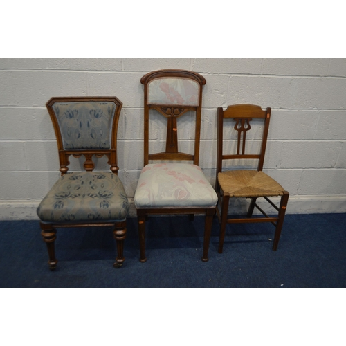 1069 - AN ART NOUVEAU OAK HIGH BACK CHAIR on cylindrical tapering front legs, along with a late Victorian o...