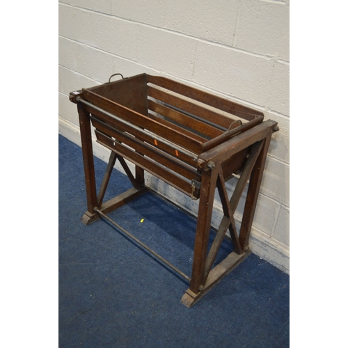 1073 - A 19TH CENTURY SCUMBLED PINE ROCKING CRIB/COT, the slatted crib with twin handles, on a removable fr...