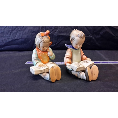 51 - 2 large heavy Goebel bookends of Girl & Boy reading...