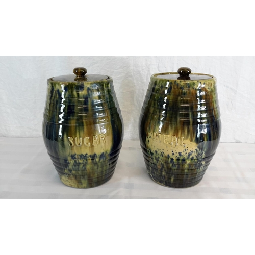 104 - 2 Scottish Kirkcaldy pottery storage jars with lids 'sugar & meal' by Morrison & Crawford. 30cm in h...