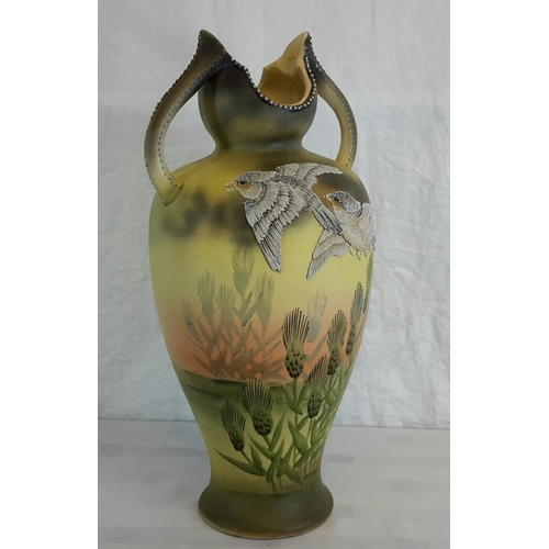 106 - A possible early Scottish 2 handled vase with 2 raised hand painted birds above hand painted thistle...
