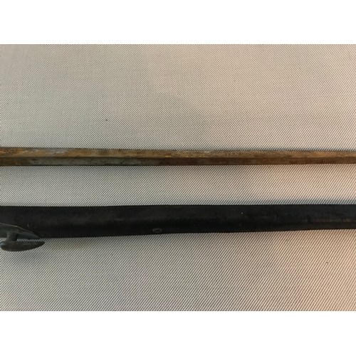 175 - British socket Bayonet Dated around 1850's. Comes with brass & leather scabbard , rust to the blade ...
