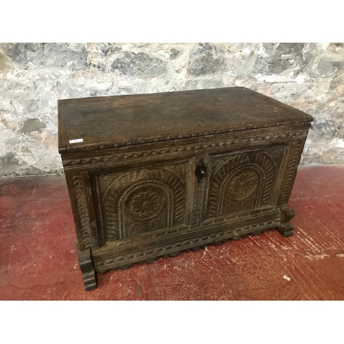 248 - 17th century Jacobean carved trunk/ chest. Has original lock and key. Measures 54x92x56cm...