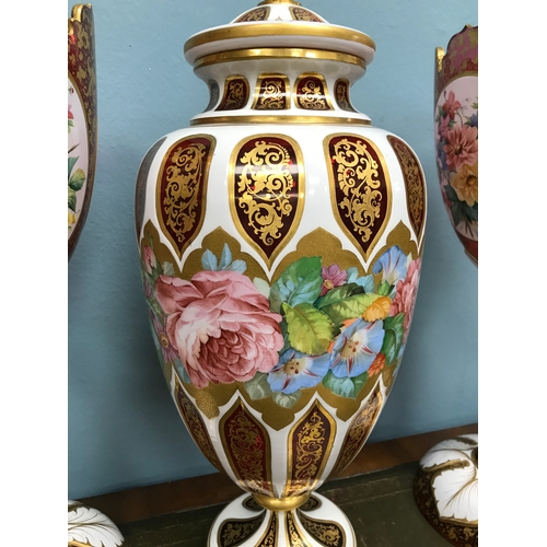 93 - A Pair of Cranberry glass Bohemian Moser White enamel overlay vases and matching urn with lid. Both ...