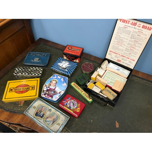 94 - A Collection of vintage advertising tins and Motorist first aid case with accessories...