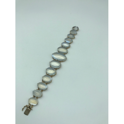 2 - An Antique gold ladies bracelet formed with Graduating moonstone gems....