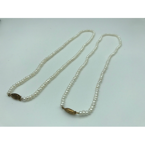 3 - A lot of two fresh sea pearl necklaces, finished with gold clasps....