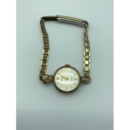 4 - A 1957 Ladies 9ct gold cased Rolex Precision watch, styled with a Rolled gold bracelet strap, comple...