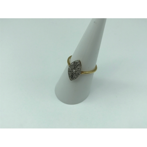 12 - A Ladies 18ct gold and Platinum Art Deco ring, designed with a clear stone centre and eight off-set ...