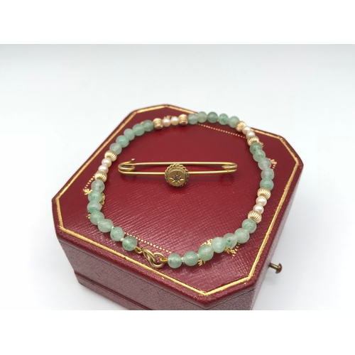 15 - A 9ct gold ladies Bangle, designed with jade, pearl and gold spheres, together with a 9ct gold eveni...