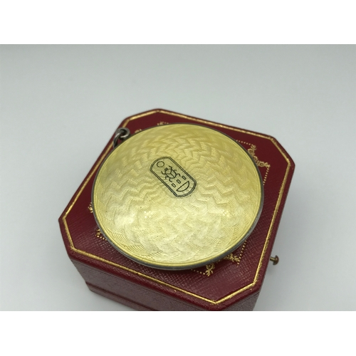 16 - A 1920s Silver and enamel Egyptian revival compact pendant, fitted with a mirror to the inside....