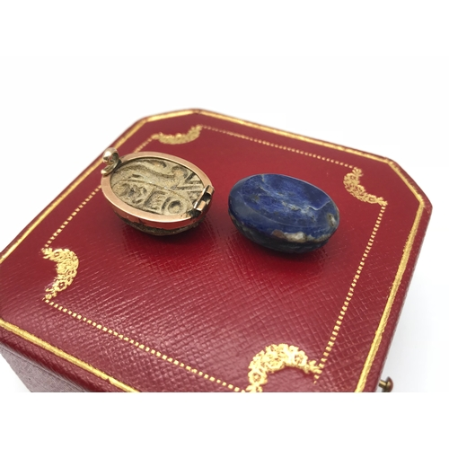 17 - An early 1900s Egyptian revival scarab beetle attached with a gold brooch framing, together with a b...