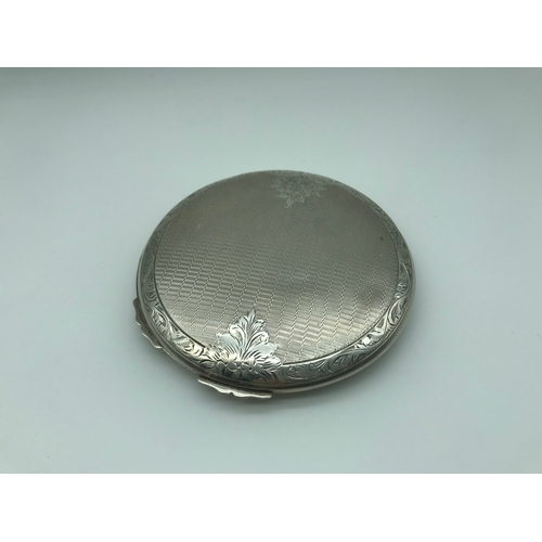32 - A Large Silver Art Deco ladies compact....