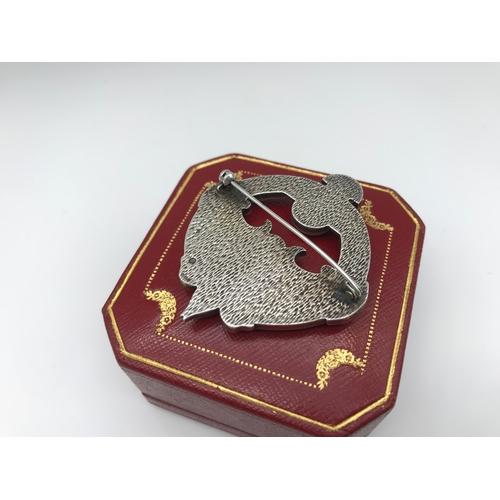 35 - An Edinburgh silver celtic design brooch by Ortak silvercraft (Malcolm Gray)...