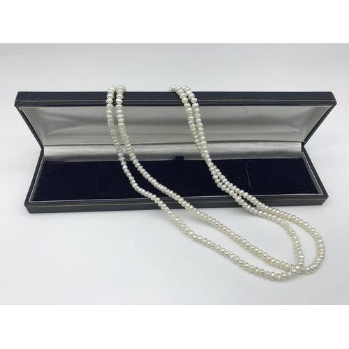 7 - A lot of two fresh sea pearl necklaces, finished with gold clasps....