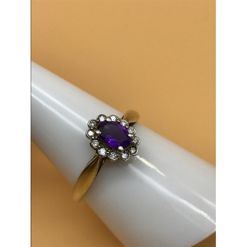 3 - A 9ct gold ladies ring set with a Large centred Amethyst stone circled by diamonds. Size O. Weighs 2...