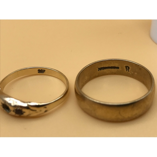 5 - A 9ct gold wedding band. Size T. Together with a 9ct gold ring. Size Q. Total weight 5.84grams...
