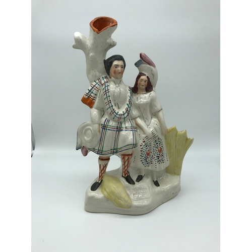 18 - A Victorian Staffordshire figure titled