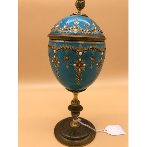 12 - A Victorian gilt metal and blue porcelain lidded goblet, In the style of a Febrege egg, Ornately Han...