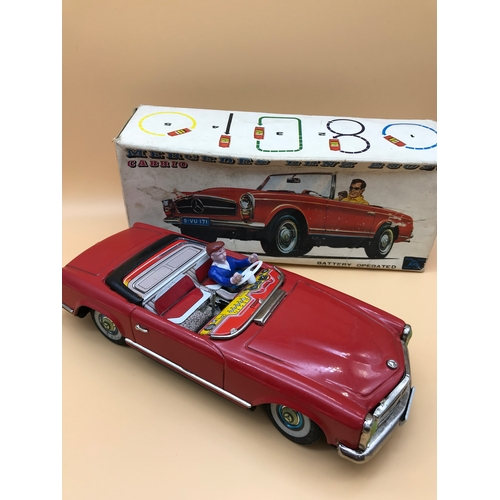23 - Alps Mercedes Benz 230sl Cabbie tinplate red car. Comes with original box...