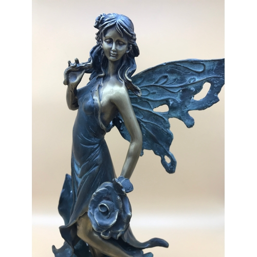 25 - A large Bronze Fairy figurine. Stands 39cm in height....