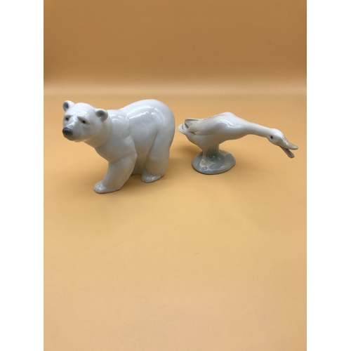 36 - A lot of 2 Lladro figurines - polar bear and swan...