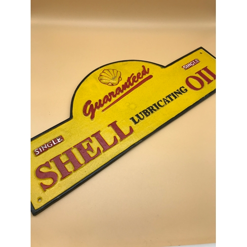 48 - Cast Iron Shell sign, Length 50cm by 20cm...