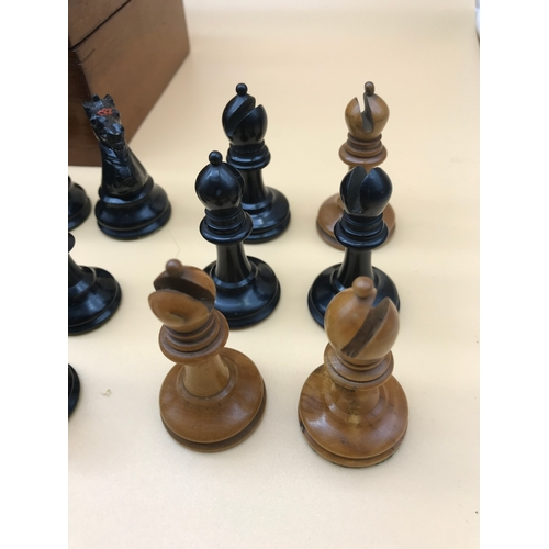 32 - A Fine example of a Antique Staunton chess set, Made from Boxwood and ebony. C1890. The King measure...