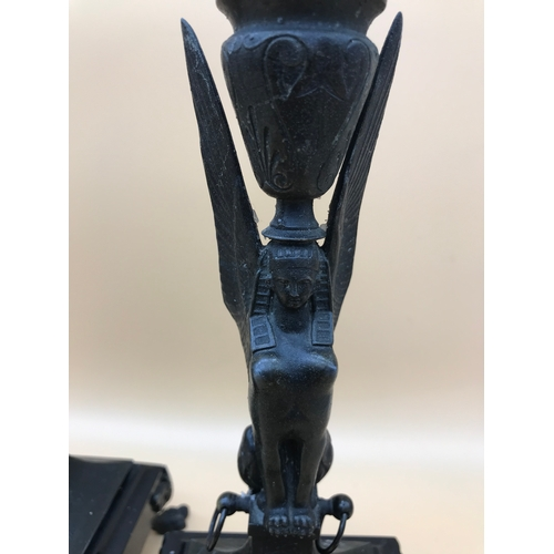 35 - A pair of Bronzed Spelter Egyptian Sphinx candle sticks, Sat upon a granite base and 4 claw feet. St...