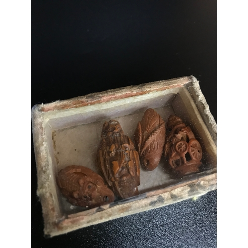 36 - A lot of 4 Antique Chinese hand carved Coquilla nuts. Kept within a small case. (Sealed)...
