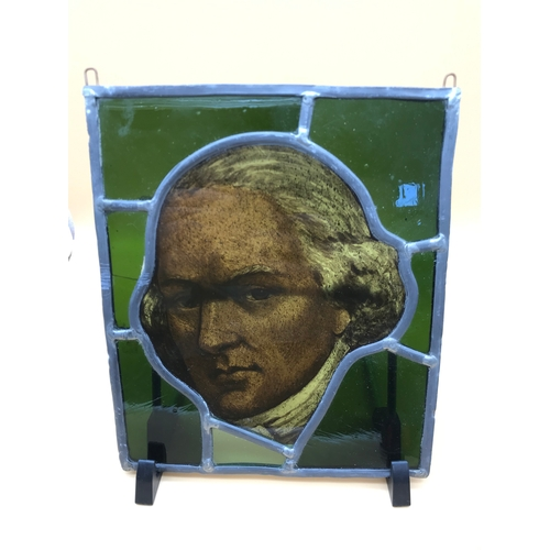 39 - An antique stain glass window panel centred with a hand painted portrait of a gentleman. Measures 24...