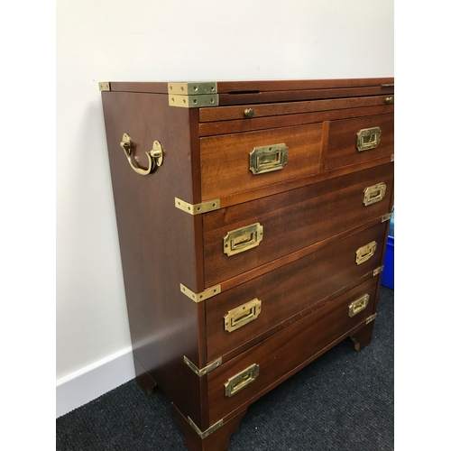 20A - A Reproduction campaign chest of drawers. Fitted with brass fitments. Measures 74x61.5x30.5cm...