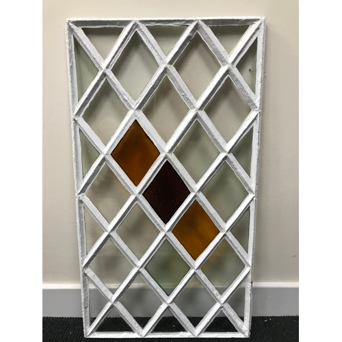 40A - A Georgian cast iron diamond shaped stainglass window panel. Measures 73x41cm (Original glass)...