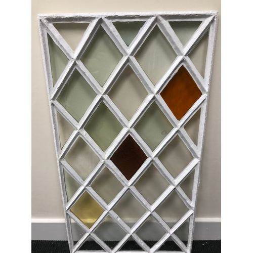 40B - A Georgian cast iron diamond shaped stainglass window panel. Measures 73x41cm (Original glass)...